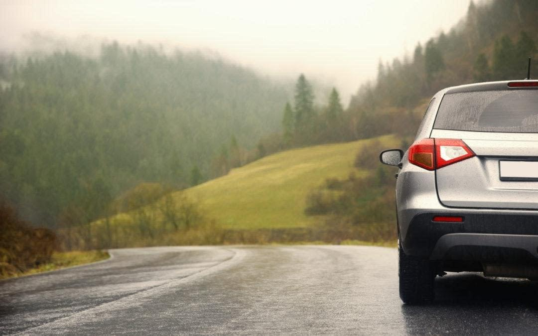 Car on country road in rainy weather