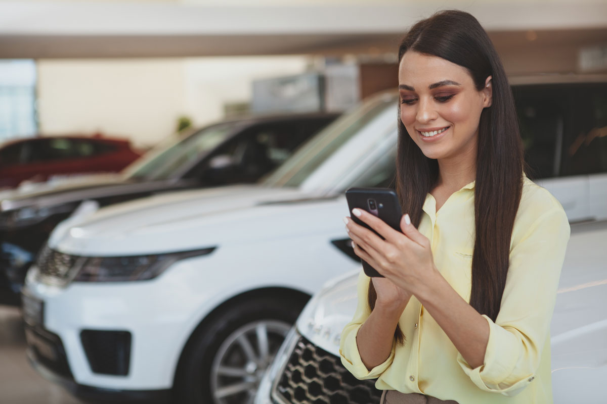 Woman Applying for a car loan on her mobile phone